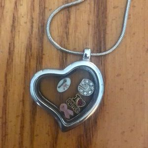 Jewelry - Heart-shaped locket with floating charms